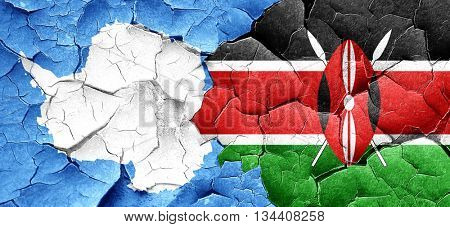 antarctica flag with Kenya flag on a grunge cracked wall