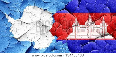antarctica flag with Cambodia flag on a grunge cracked wall