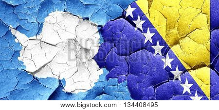 antarctica flag with Bosnia and Herzegovina flag on a grunge cra