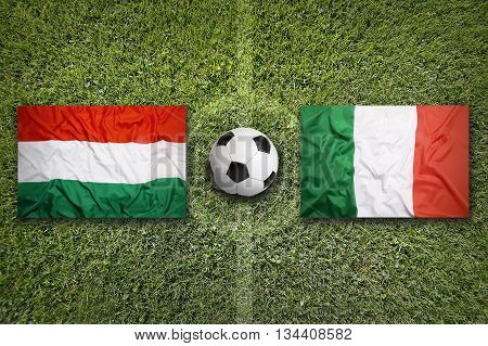 Hungary Vs. Italy Flags On Soccer Field