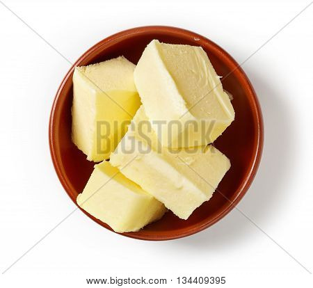 Butter In Bowl Isolated On White, From Above