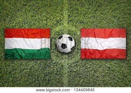 Hungary Vs. Austria Flags On Soccer Field