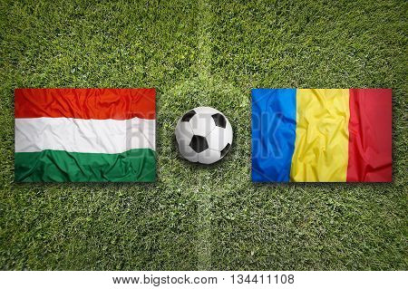 Hungary Vs. Romania Flags On Soccer Field