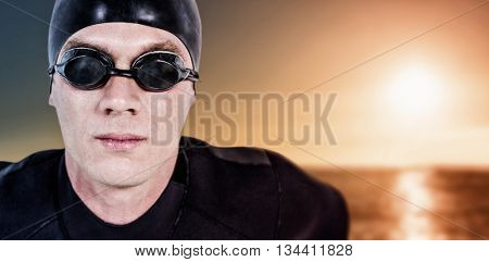 Close-up of confident swimmer in wetsuit against sunset of a beautiful day