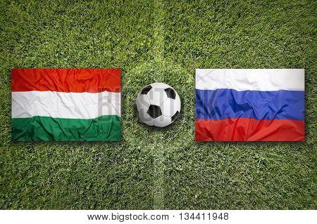 Hungary Vs. Russia Flags On Soccer Field