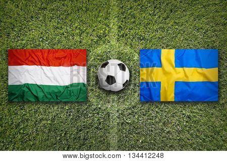 Hungary Vs. Sweden Flags On Soccer Field