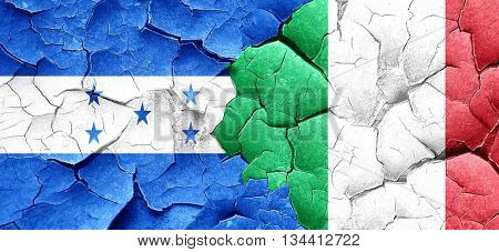 Honduras flag with Italy flag on a grunge cracked wall