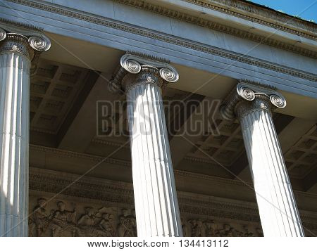Columns capitals relief friez ornaments and seiling decoration of portico. Entrance to the Moscow Museum of Fine Arts