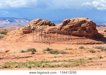 Layered Rock In Dry And Arid Desert Around Glen Canyon National Recreation  Area