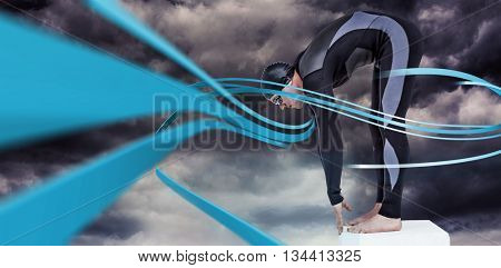Swimmer in wetsuit preparing to dive against gloomy sky