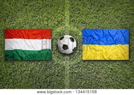 Hungary Vs. Ukraine Flags On Soccer Field