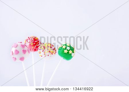 Colorful cake pops isolated on white background