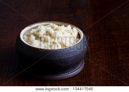 Horseradish Sauce In Rustic Pottery Bowl In Perspective On Dark Wood. Place For Text.
