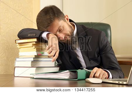 business man tired of working with books and documents