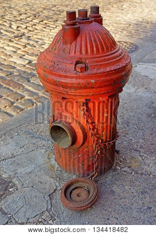 Open Street Fire Hydrant on the road in Philadelphia Pennsylvania the USA.