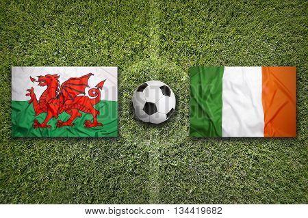 Wales Vs. Ireland Flags On Soccer Field