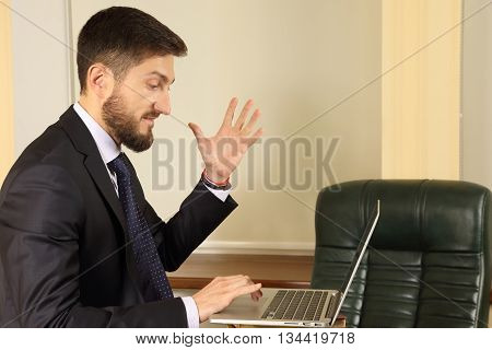 business man in emotion when working with a laptop