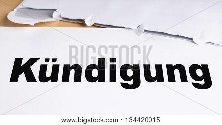 Kuendigung german termination letter with opened envelope on desk