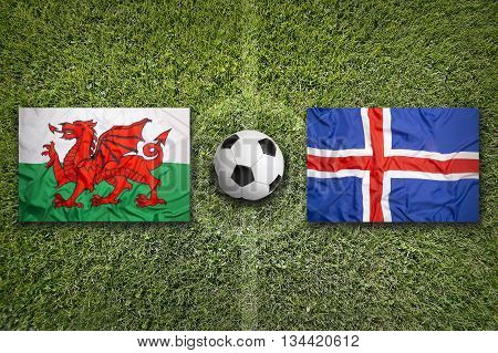 Wales Vs. Iceland Flags On Soccer Field