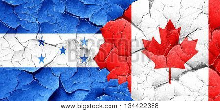 Honduras flag with Canada flag on a grunge cracked wall