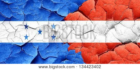 Honduras flag with Austria flag on a grunge cracked wall