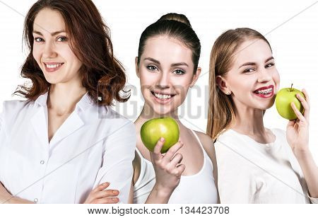 Happy patient with braces on the teeth and doctor dentist isolated on white. Healthy smile concept