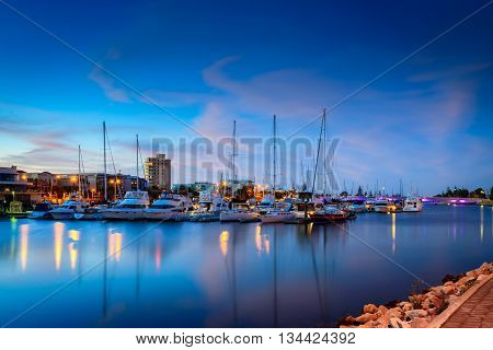 Adelaide Australia - November 8 2014: Boats parked in the docks of Patawalonga lake at Glenelg at dusk. Some boats can be a bit blurry due to waves.