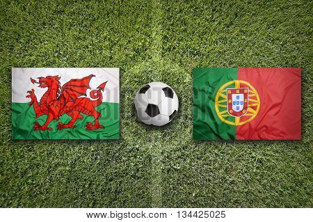 Wales Vs. Portugal Flags On Soccer Field