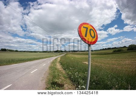 Road with traffic sign speed limit 70 km/h