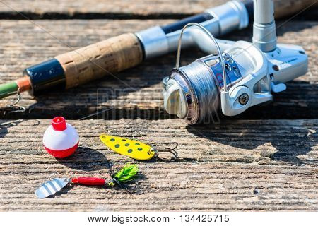 fishing rod, lure, and hook on jetty, preparations for sport angling