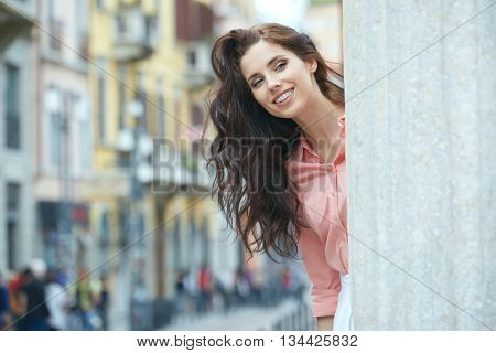 beautiful woman walking and running joyful and cheerful smiling in Milan, Italy.