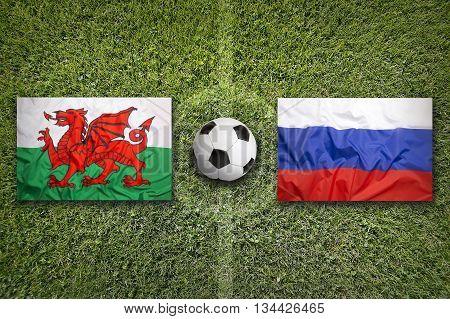 Wales Vs. Russia Flags On Soccer Field