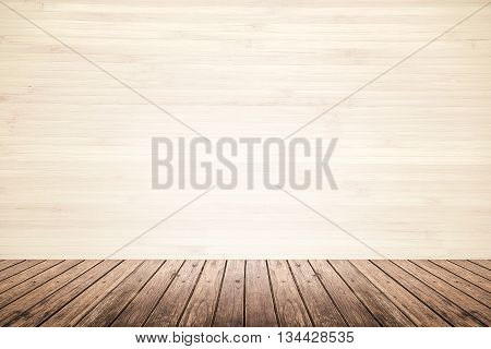 Empty room interior of old grunge beige wood wall and dark brown wooden floor use for background backdrop or design element in architecture concept