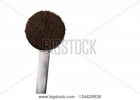 A silver coffee scoop filled with coffee grounds isolated on white.
