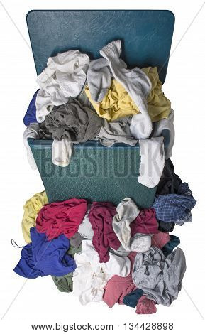 Dirty laundry piled up overflowing in a green or turquoise hamper isolated on white.