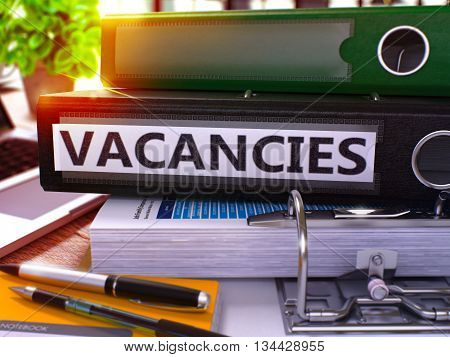 Vacancies - Black Ring Binder on Office Desktop with Office Supplies and Modern Laptop. Vacancies Business Concept on Blurred Background. Vacancies - Toned Illustration. 3D Render.