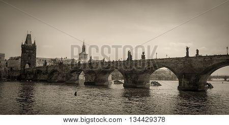 Vintage image of Charles bridge and Vltava river in Prague.