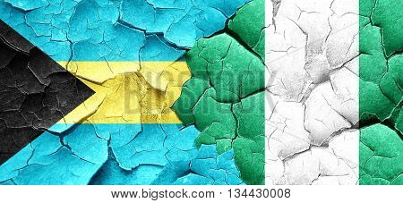 Bahamas flag with Nigeria flag on a grunge cracked wall