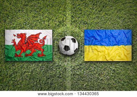 Wales Vs. Ukraine Flags On Soccer Field