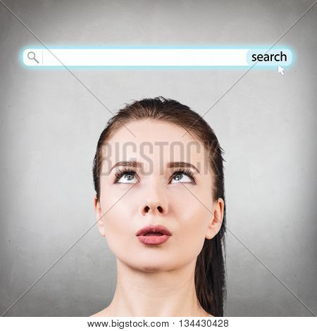 Portrait of confused woman looking up on the searching line