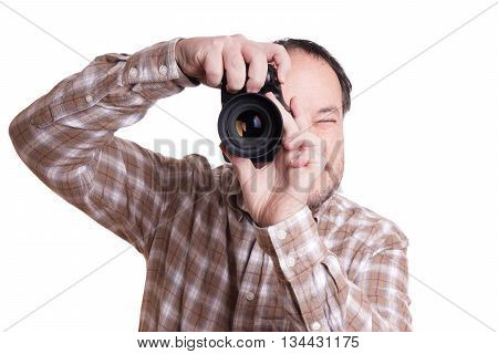 male photographer taking photo with dslr camera