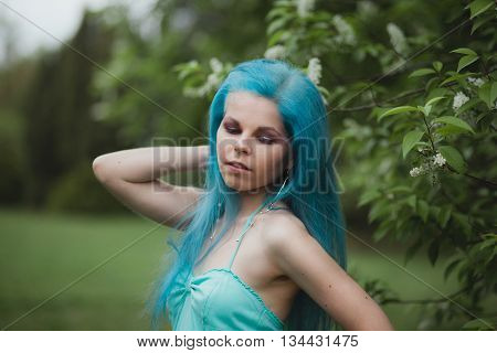 Close Up Portrait Of Girl With Blue Hair Outdoors In Spring. Beautiful Stylish Woman. Barbershop Adv