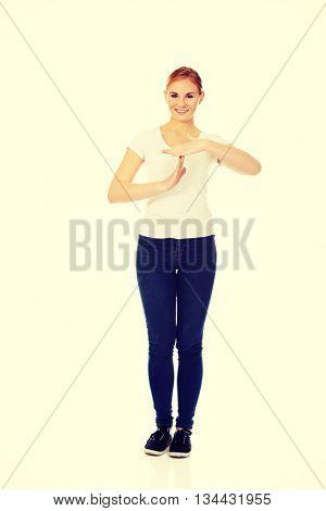 Young woman doing a break symbol