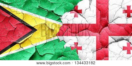 Guyana flag with Georgia flag on a grunge cracked wall