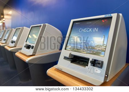NEW YORK - MARCH 14, 2016: check-in kiosks in JFK airport. John F. Kennedy International Airport is a major international airport located in the Queens borough of New York City, United States.