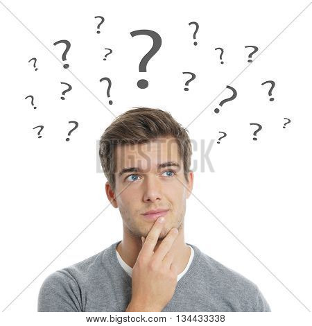 pensive young man with question marks isolated on white