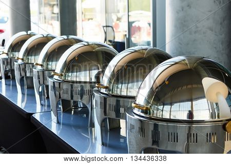 The buffet Table with Row of Food Service Steam Pans