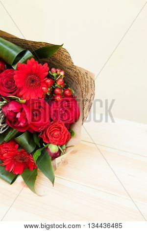 Closeup Shot Of Red Bouquet Of Roses, Gerberas, Peonies, Pomegranates With Copyspace. Love And Passi