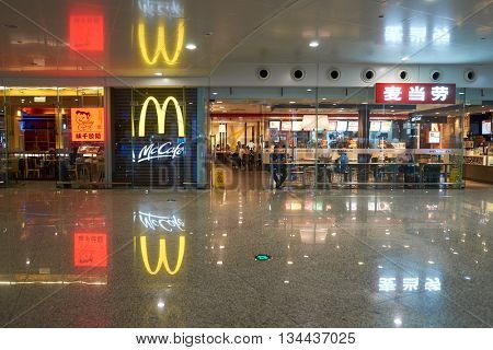 SHENZHEN, CHINA - MAY 07, 2016: McDonald's restaurant in ShenZhen international airport. McDonald's is the world's largest chain of hamburger fast food restaurants, founded in the United States.
