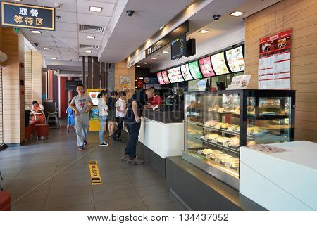 SHENZHEN, CHINA - MAY 06, 2016: inside of McDonald's restaurant. McDonald's is the world's largest chain of hamburger fast food restaurants, founded in the United States.